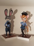 2girls alternative_hairstyle belt cosmetics crossover gadget hairband handcuffs judy_hopps police_badge police_uniform shirt skirt statuette stuff thighhighs tress zak zootopia // 3024x4032 // 8.0MB